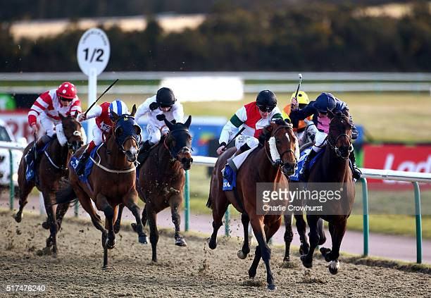 Adam Kirby rides Grendisar to win The Coral Easter Classic all weather middle distance championships conditions stakes during the All Weather...