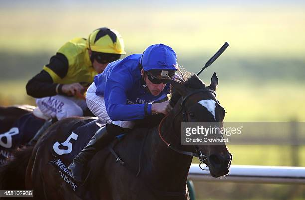 Adam Kirby rides Tearless to win The 32Red/ebfstallionscom Fleur De Lys Fillies' Stakes at Lingfield racecourse on October 30 2014 in Lingfield...