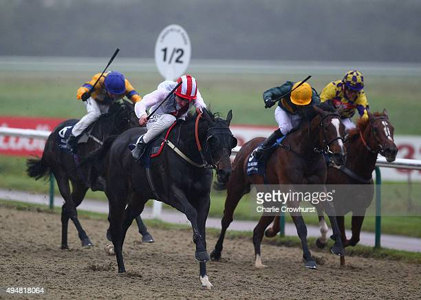 Adam Kirby rides Urban Castle to win The 32Redcom / EBF Stallions River Eden Fillies Sakes at Lingfield Park on October 29 2015 in Lingfield England