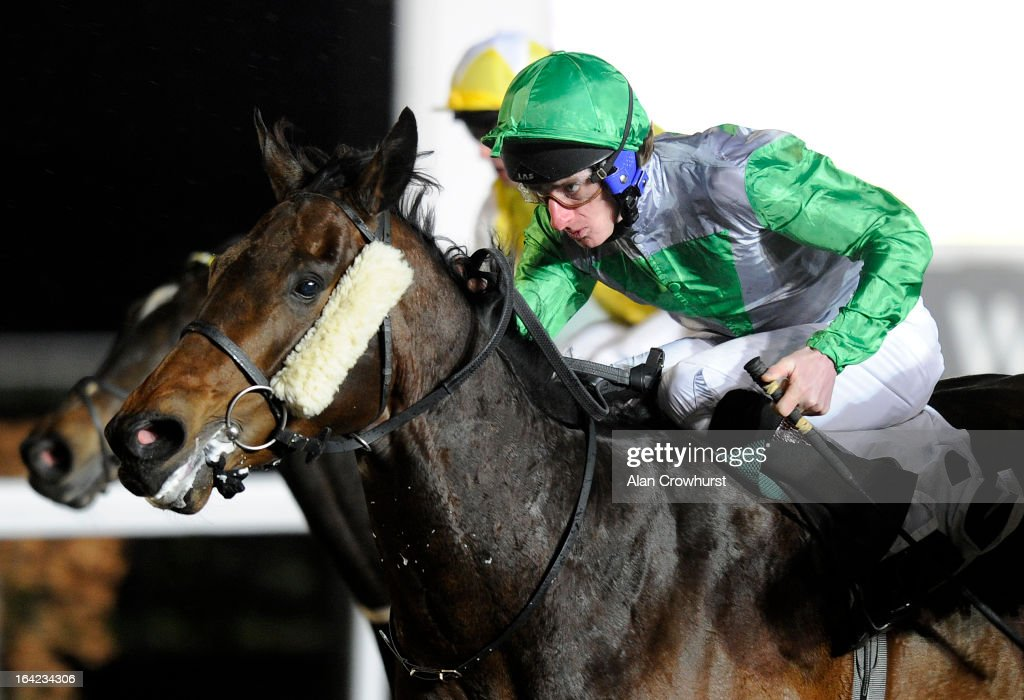 <a gi-track='captionPersonalityLinkClicked' href=/galleries/search?phrase=Adam+Kirby&family=editorial&specificpeople=241329 ng-click='$event.stopPropagation()'>Adam Kirby</a> riding Camachoice win The BetVictor Aintree Grand National NRNB Handicap Stakes at Kempton racecourse on March 21, 2013 in Sunbury, England.