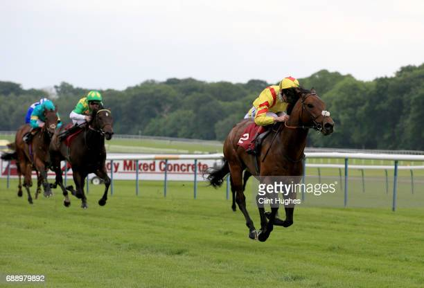 Adam Kirby riding Harry Angel leads the field home to win the Armstrong Aggregates Sandy Lane Stakes at Haydock Racecourse on May 27 2017 in Haydock...