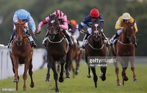 Adam Kirby riding Laidback Romeo win The Download The Betdaq App Handicap Stakes at Windsor racecourse on June 22 2015 in Windsor England