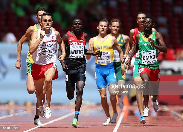 Adam Kszczot of Poland Alfred Kipketer of Kenya and Jena Umar of Ethiopia race to the line in the Men's 800 metres heats during day one of the 15th...