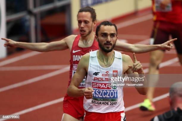 Adam Kszczot of Poland celebrates as he crosses the finish line to win the gold medal during the Men's 800 metres final on day three of the 2017...