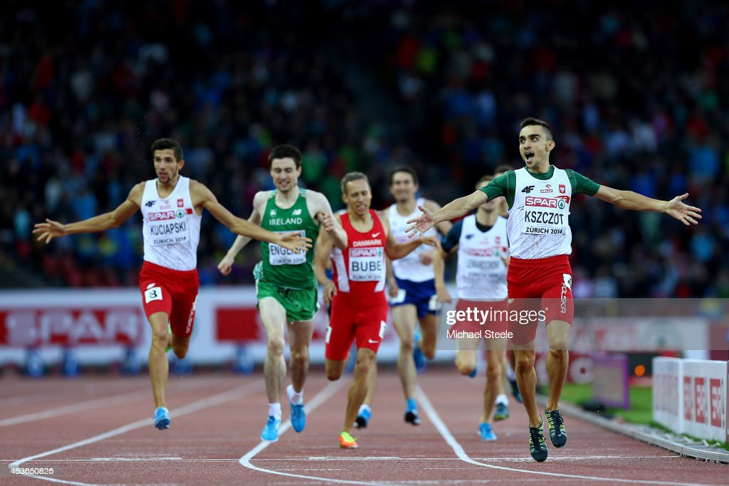 <a gi-track='captionPersonalityLinkClicked' href=/galleries/search?phrase=Adam+Kszczot&family=editorial&specificpeople=5746296 ng-click='$event.stopPropagation()'>Adam Kszczot</a> of Poland celebrates winning gold ahead of Artur Kuciapski of Poland and Mark English of Ireland in the Men's 800 metres final during day four of the 22nd European Athletics Championships at Stadium Letzigrund on August 15, 2014 in Zurich, Switzerland.