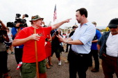 Adam Kwasman a Tea Party patriot running for congress has a heated discussion with an antiimmigration activist during a protest along Mt Lemmon Road...