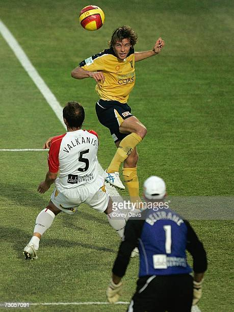 Adam Kwasnik of the Mariners heads the ball over Michael Valkanis of United during round 21 Hyundai ALeague match between the Central Coast Mariners...