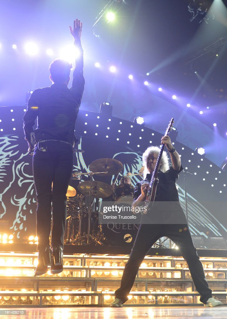 Adam Labert (L) and <a gi-track='captionPersonalityLinkClicked' href=/galleries/search?phrase=Brian+May&family=editorial&specificpeople=158059 ng-click='$event.stopPropagation()'>Brian May</a> of Queen perform onstage during the iHeartRadio Music Festival at the MGM Grand Garden Arena on September 20, 2013 in Las Vegas, Nevada.