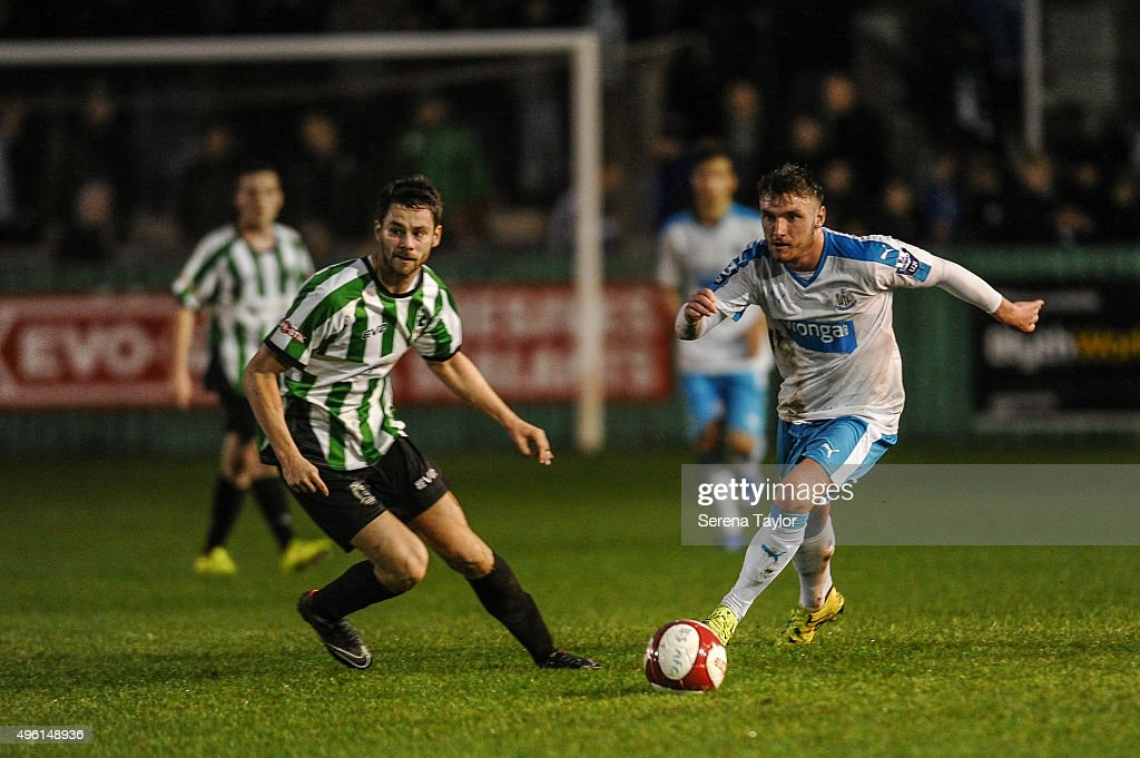 Adam Laidler (R) of Newcastle controls the ball during The Northumberland Senior Cup match between Blyth Spartans and Newcastle United at Croft Park on November 7, 2015, in Blyth, England.