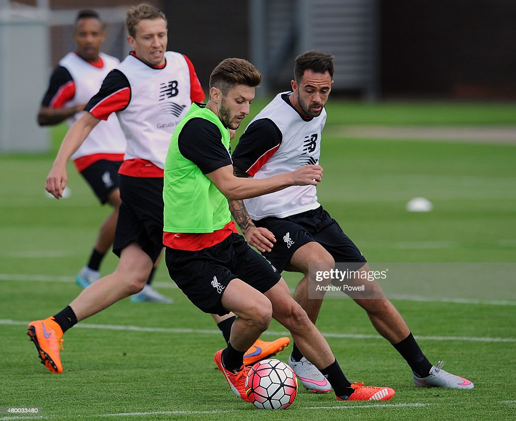 Adam Lallana and Danny Ings of Liverpool during a training session at Melwood Training Ground on July 9, 2015 in Liverpool, England.