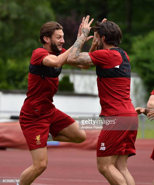 Adam Lallana and Danny Ings of Liverpool during a training session at RottachEgern on July 28 2017 in Munich Germany