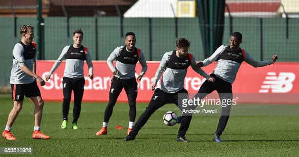 Adam Lallana and Georginio Wijnaldum of Liverpool during a training session at Melwood Training Ground on March 15 2017 in Liverpool England