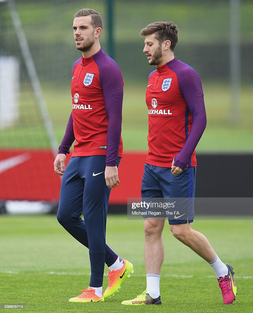 <a gi-track='captionPersonalityLinkClicked' href=/galleries/search?phrase=Adam+Lallana&family=editorial&specificpeople=5475862 ng-click='$event.stopPropagation()'>Adam Lallana</a> and <a gi-track='captionPersonalityLinkClicked' href=/galleries/search?phrase=Jordan+Henderson&family=editorial&specificpeople=4940390 ng-click='$event.stopPropagation()'>Jordan Henderson</a> of England look on during an England training session at London Colney on May 30, 2016, near St Albans, England.
