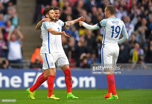 Adam Lallana and Kyle Walker of England celebrate the second goal scored by Jamie Vardy during the FIFA 2018 World Cup Qualifier between England and...