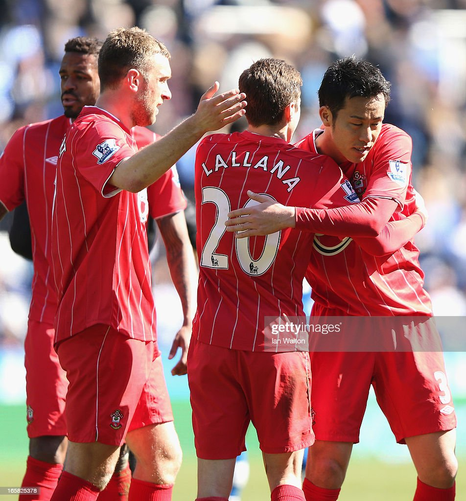 <a gi-track='captionPersonalityLinkClicked' href=/galleries/search?phrase=Adam+Lallana&family=editorial&specificpeople=5475862 ng-click='$event.stopPropagation()'>Adam Lallana</a> and <a gi-track='captionPersonalityLinkClicked' href=/galleries/search?phrase=Maya+Yoshida&family=editorial&specificpeople=5398323 ng-click='$event.stopPropagation()'>Maya Yoshida</a> of Southampton celebrate victory after the Barclays Premier League match between Reading and Southampton at the Madejski Stadium on April 6, 2013 in Reading, England.