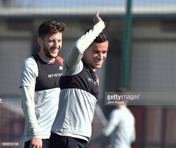 Adam Lallana and Philippe Coutinho of Liverpool during a training session at Melwood Training Ground on March 15 2017 in Liverpool England