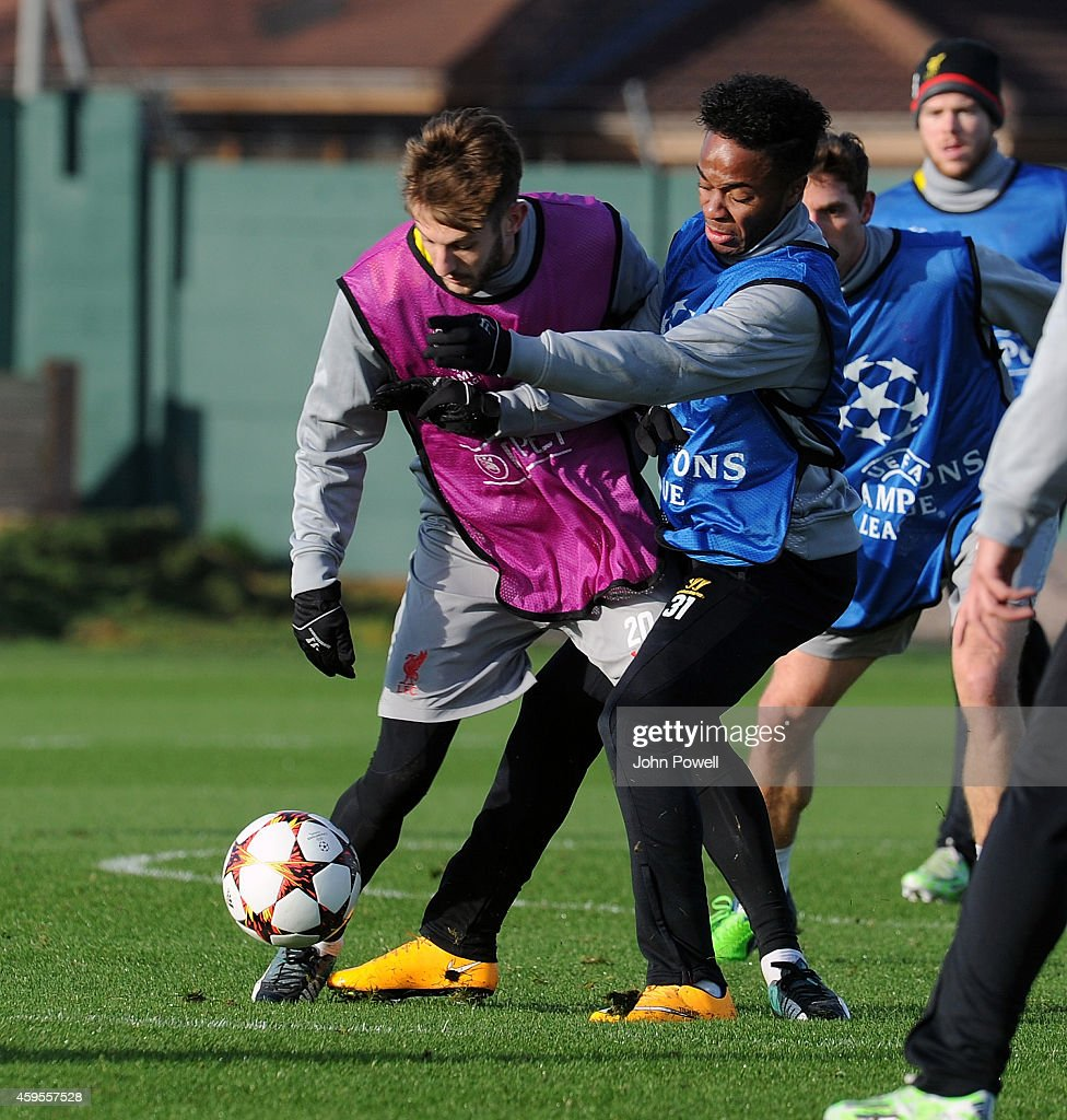 Adam Lallana and Raheem Sterling of Liverpool during a training session prior the match between PFC Ludogorets Razgrad and Liverpool at Melwood Training Ground on November 25, 2014 in Liverpool, England.