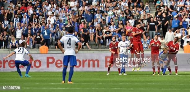 Adam Lallana Dominic Solanke Emre Can Philippe Coutinho and Georginio Wijnaldum of Liverpool defend a free kick from Marvin Plattenhardt of Hertha...