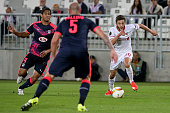 Adam Lallana for Liverpool FC and Pablo for Girondins de Bordeaux fight for the ball during the Europa League game between FC Girondins de Bordeaux...