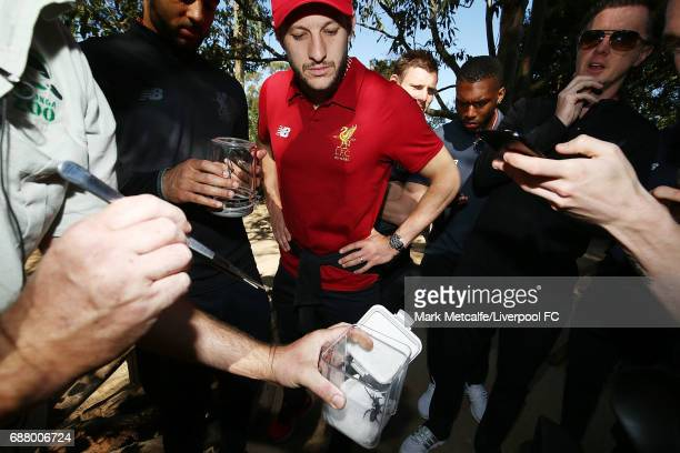 Adam Lallana looks at spiders during a Liverpool FC player visit to Taronga Zoo on May 25 2017 in Sydney Australia