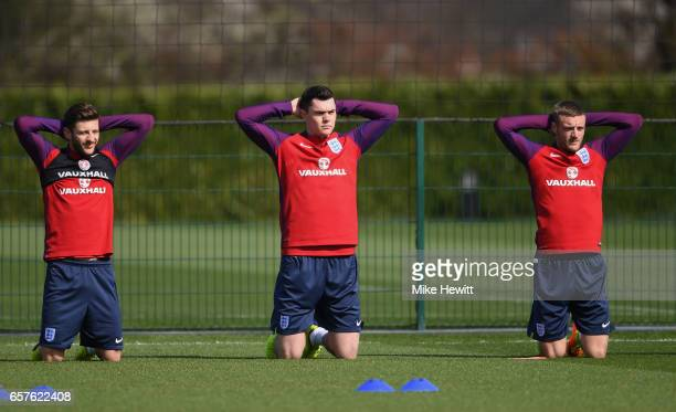 Adam Lallana Michael Keane and Jamie Vardy of England run through drills during the England training session at the Tottenham Hotspur Training Centre...