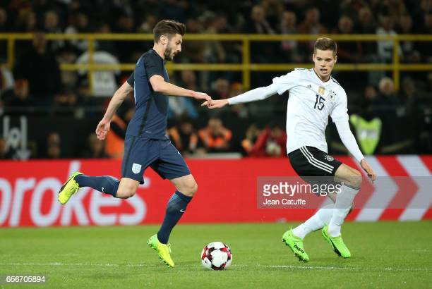 Adam Lallana of England and Julian Weigl of Germany in action during the international friendly match between Germany and England at Signal Iduna...