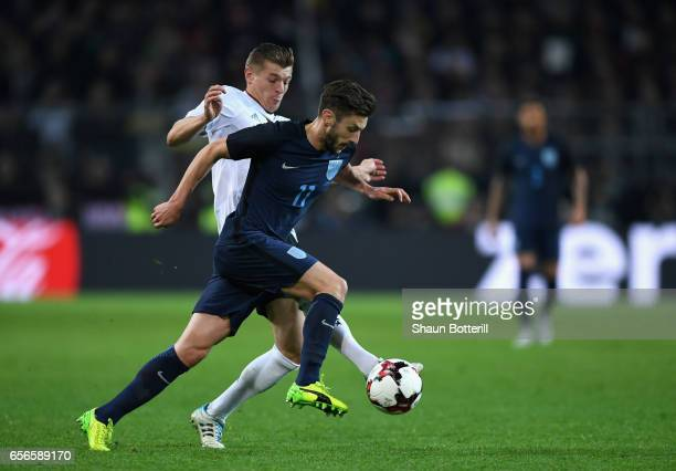 Adam Lallana of England and Toni Kroos of Germany battle for possession during the international friendly match between Germany and England at Signal...