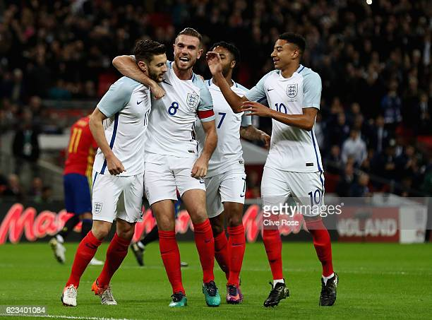 Adam Lallana of England celebrates with team mates after scoring the opening goal of the game during the international friendly match between England...