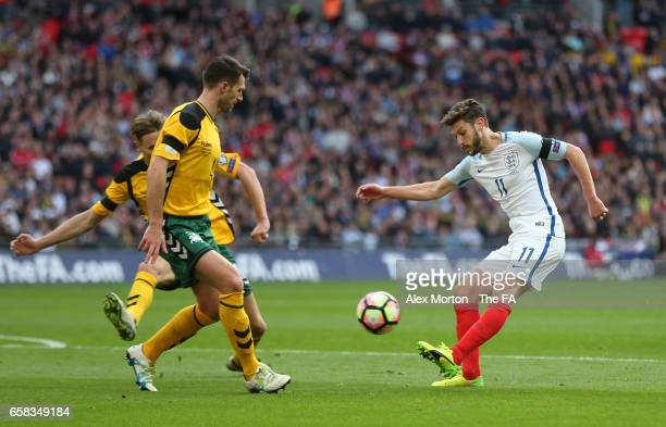 Adam Lallana of England crosses during the FIFA 2018 World Cup Qualifier between England and Lithuania at Wembley Stadium on March 26 2017 in London...