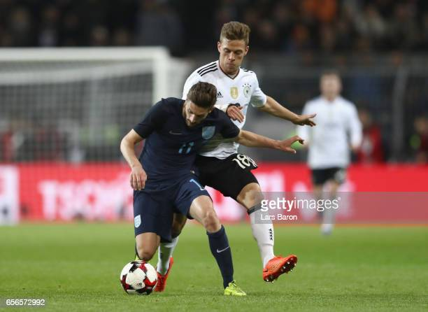 Adam Lallana of England is closed down by Joshua Kimmich of Germany during the international friendly match between Germany and England at Signal...