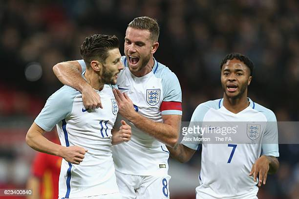 Adam Lallana of England is congratulated by Jordan Henderson after scoring the opening goal during the international friendly match between England...