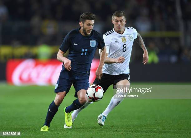 Adam Lallana of England is put under pressure from Toni Kroos of Germany during the international friendly match between Germany and England at...