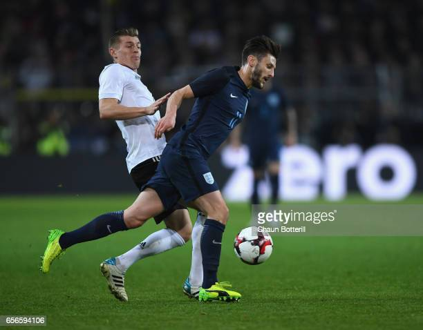Adam Lallana of England is tackled by Toni Kroos of Germany during the international friendly match between Germany and England at Signal Iduna Park...