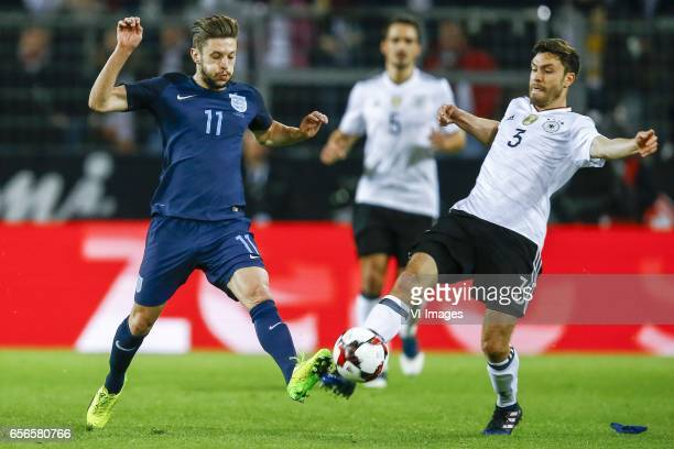Adam Lallana of England Jonas Hector of Germanyduring the friendly match between Germany and England on March 22 2017 at the Signal Iduna Park...