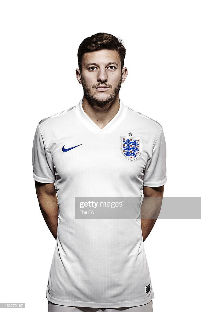 <a gi-track='captionPersonalityLinkClicked' href=/galleries/search?phrase=Adam+Lallana&family=editorial&specificpeople=5475862 ng-click='$event.stopPropagation()'>Adam Lallana</a> of England poses for a portrait during an England Football Squad Portrait session ahead of the 2014 World Cup in Brazil.
