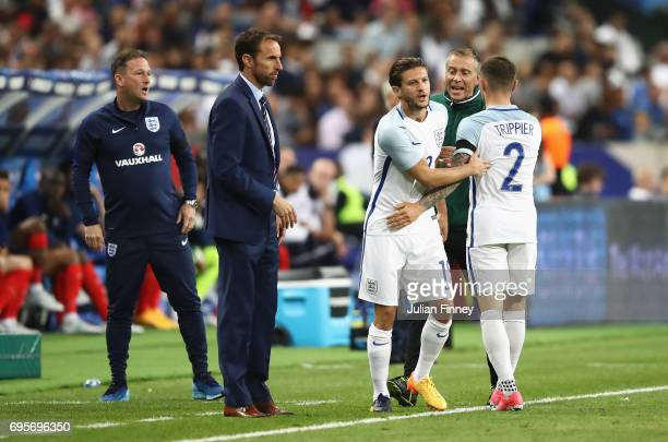 Adam Lallana of England replaces Kieran Trippier of England as a substitute as Gareth Southgate manager of England looks on during the International...