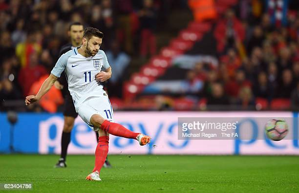 Adam Lallana of England scores the opening goal from the penalty spot during the international friendly match between England and Spain at Wembley...