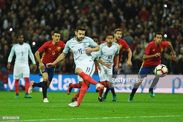 Adam Lallana of England scores their first goal from the penalty spot during the international friendly match between England and Spain at Wembley...
