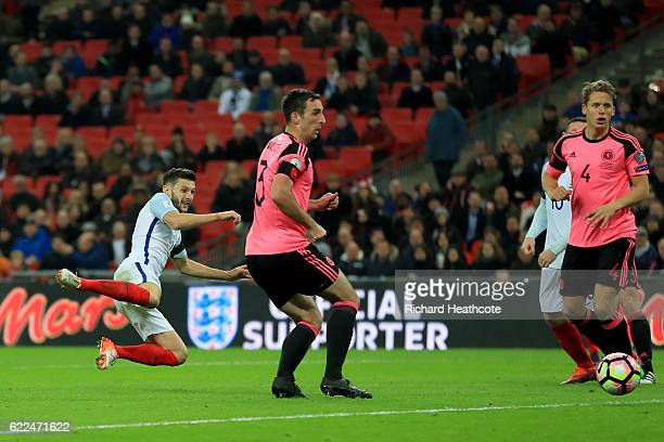 Adam Lallana of England scores their second goal during the FIFA 2018 World Cup qualifying match between England and Scotland at Wembley Stadium on...