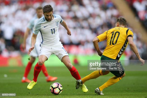 Adam Lallana of England takes on Arturas Zulpa of Lithuania during the FIFA 2018 World Cup Qualifier between England and Lithuania at Wembley Stadium...