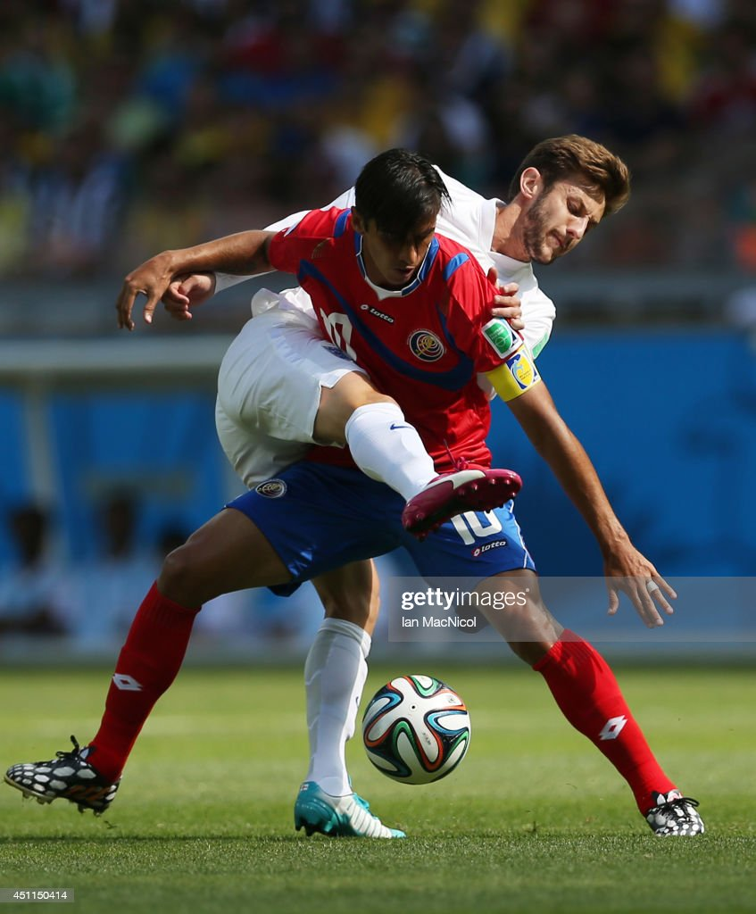 Adam Lallana of England vies with Bryan Ruiz of Costa Rica during the 2014 FIFA World Cup Brazil Group D match between Costa Rica and England at...