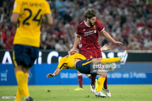 Adam Lallana of FC Liverpool and Angel Correa of Atletico Madrid fight for the ball during the Audi Cup 2017 match between Liverpool FC and Atletico...