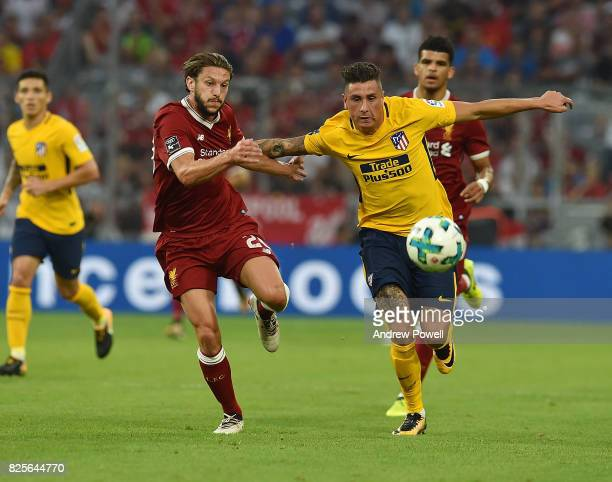 Adam Lallana of Liveprool competes with Jose Gimenez of Atletico Madrid during the Audi Cup 2017 match between Liverpool FC and Atletico Madrid at...