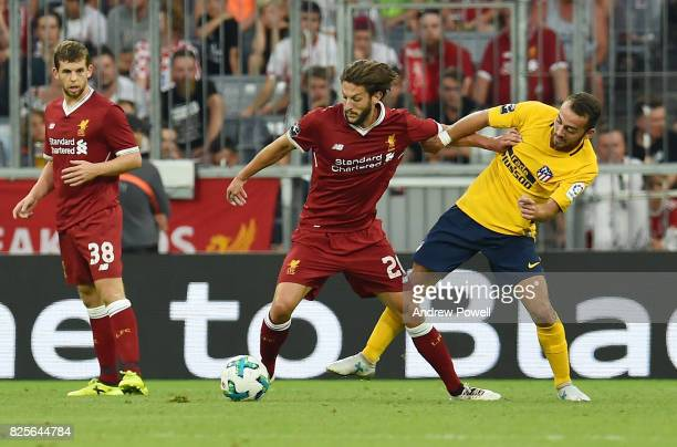 Adam Lallana of Liveprool competes with Keidi Bare of Atletico Madrid during the Audi Cup 2017 match between Liverpool FC and Atletico Madrid at...