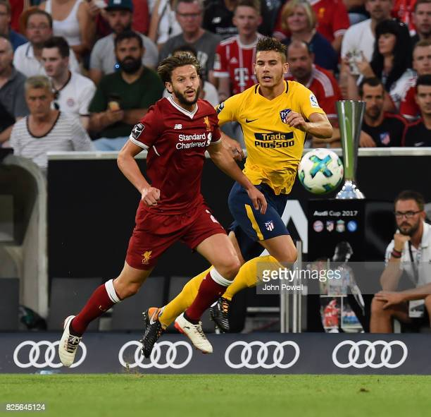 Adam Lallana of Liveprool competes with Lucas Hernandez of Atletico Madrid during the Audi Cup 2017 match between Liverpool FC and Atletico Madrid at...