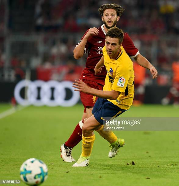 Adam Lallana of Liveprool competes with Sergi of Atletico Madrid during the Audi Cup 2017 match between Liverpool FC and Atletico Madrid at Allianz...