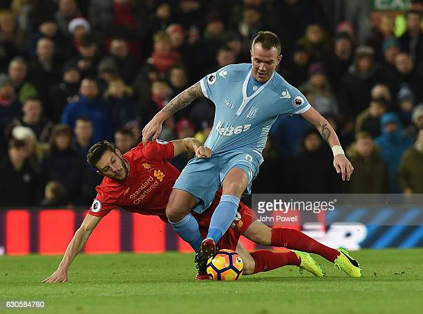 Adam Lallana of Liveprool with Stoke Citys Glenn Whelan during the Premier League match between Liverpool and Stoke City at Anfield on December 27...