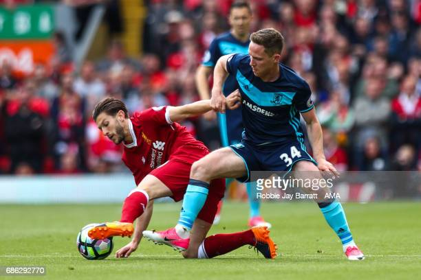 Adam Lallana of Liverpool and Adam Forshaw of Middlesbrough during the Premier League match between Liverpool and Middlesbrough at Anfield on May 21...