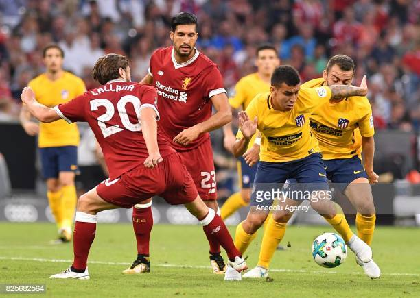 Adam Lallana of Liverpool and Angel Correa of Atletico Madrid vie for the ball during the Audi Cup soccer final match between FC Liverpool and...