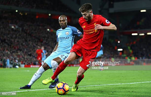 Adam Lallana of Liverpool and Fernandinho of Manchester City in action during the Premier League match between Liverpool and Manchester City at...